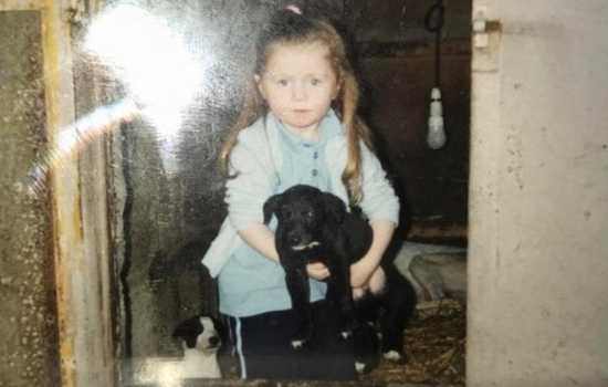 Debbie O'Rourke as a child with greyhound puppies